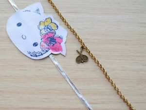 Gold Tennis Racket Bracelet with Kitty Rakhi
