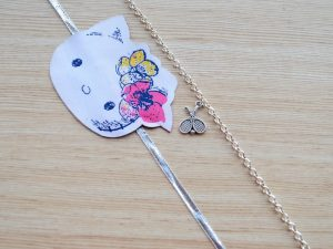 Silver Tennis Racket Bracelet with Kitty Rakhi