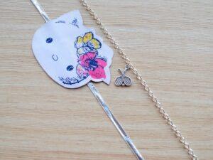 Silver Tennis Racket Bracelet with Kitty Rakhi