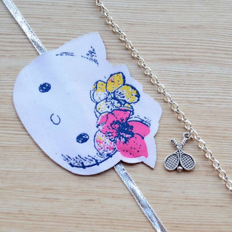 Silver Tennis Racket Bracelet with Kitty Rakhi |