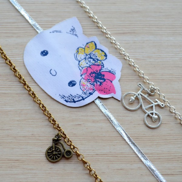 Beautiful Gift Set of Gold and Silver Plated Cycle Bracelets with Hello Kitty Rakhi for Kids |