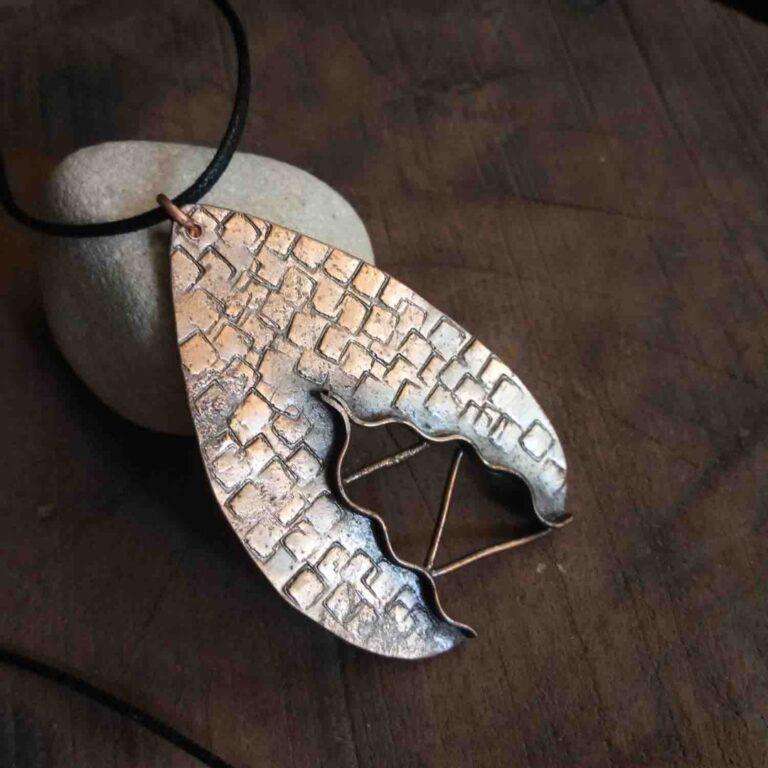Bridging the gap pendant |