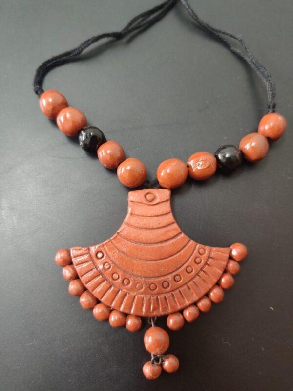 Terracotta Fancy Pendant With Black Beads |