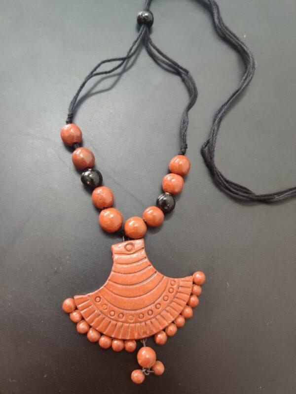 Terracotta Fancy Pendant With Black Beads  